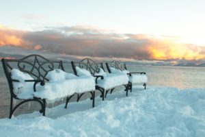 Snowy benches on the dock at Franciscan Lakeside Lodge